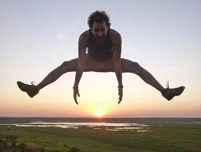 Jacob jumping over the sunset at Ubirr
